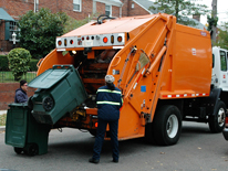 large trash container being emptied into truck