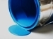 tipped-over can spilling paint