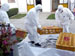 men in hazmat suits moving crates
