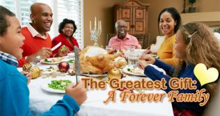 Image of family around dinner table