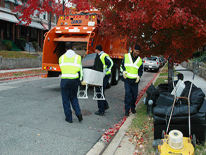 Trash collectors picking up bulk items