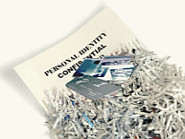 Sensitive documents and credit cards being shredded