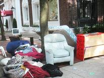 photo of furniture and household items on the curb