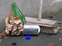 photo of broom sweeping up garbage
