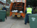 Trash collectors picking up yard waste items